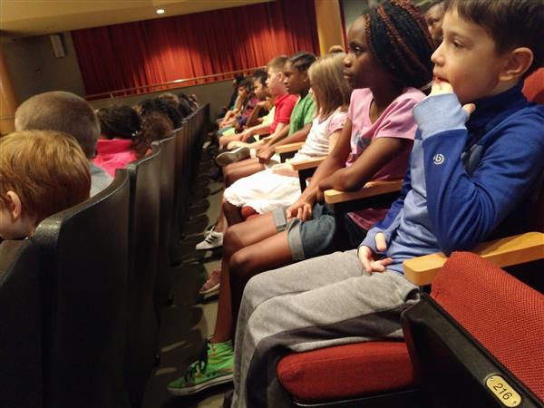 Students listening to story teller Donna Washington