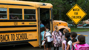 Picture of children getting on a school bus