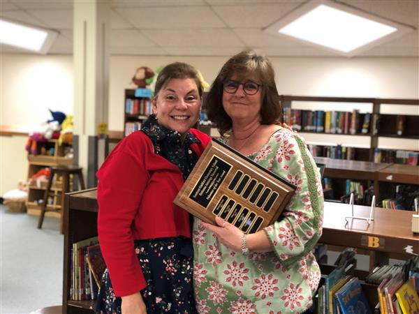 Volunteer of the year receives plaque