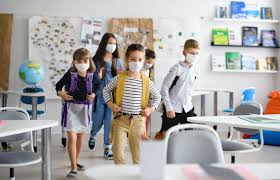 Kids in a classroom wearing masks