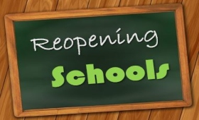 sign on chalkboard - Reopening Schools