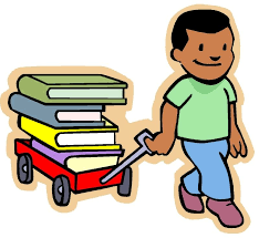 boy pulling books in wagon