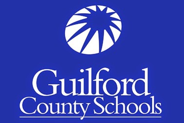 Guilford County Schools logo in white over a blue background with a star in the background