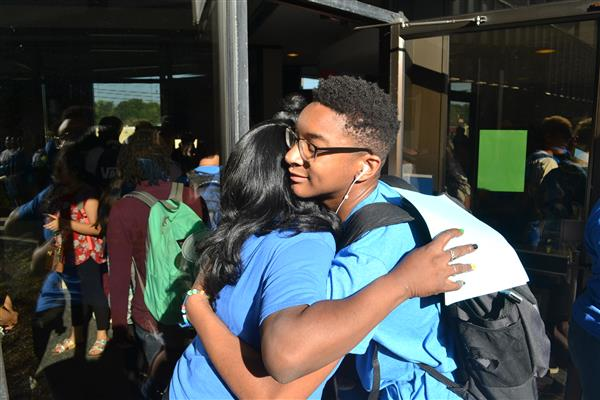 Student Receives Hug at The Academy at Smith