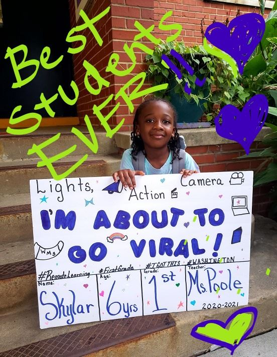 Student holding sign of remote learning for the first day of school