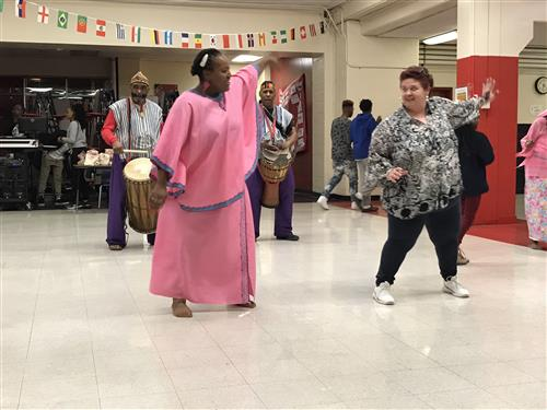 Otesha creative arts group dancing with parents at Welborn Academy Multicultural night