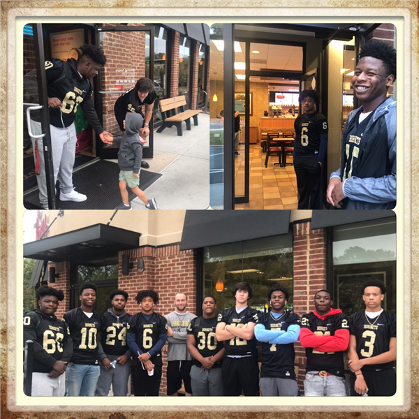 pictures of the football players assist and helping out at Chic-Fil-A