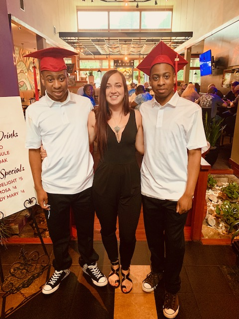 Two 2019 Graduates and teacher
