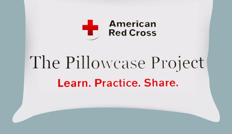 white pillowcase with american red cross lettering