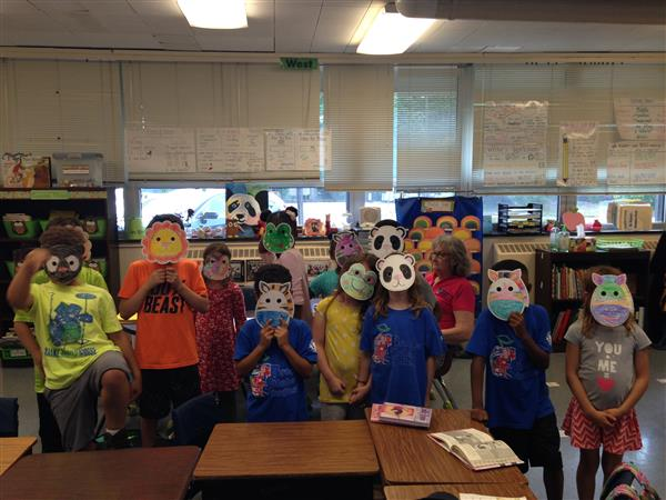 ACES students in mask that they decorated