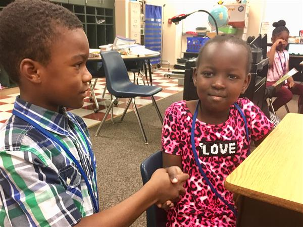 Students Shake Hands at Brightwood Elementary