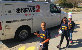 kids in front of news van