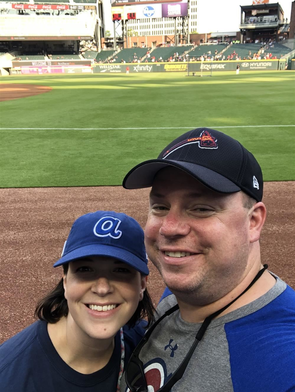 My beautiful wife, Olivia, and I at our favorite place, an Atlanta Braves baseball game
