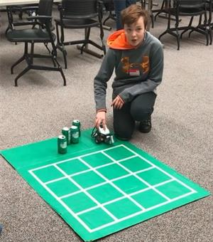 Student working on an AI car challenge