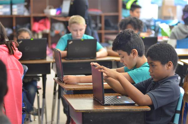 Students using laptops in a classroom