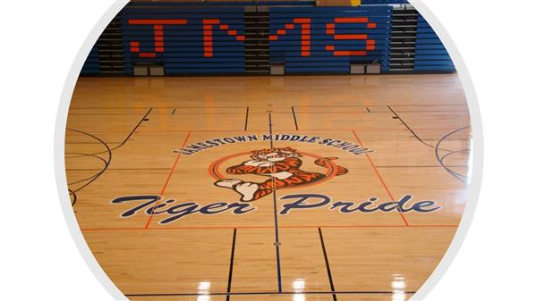 jamestown middle school basketball court with the logo and stadium seating
