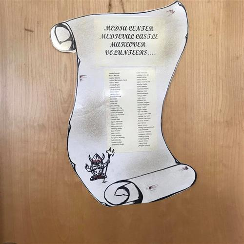"poster that looks like a scroll and says ""Media Center Medieval Castle Makeover Volunteers"" with a list of names and a viking picture"