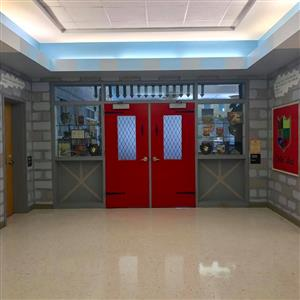 Red doors leading to library from hallway
