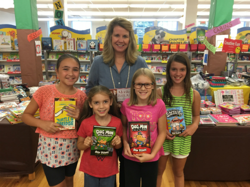 Picture of Mrs. Dalton at the book fair with students
