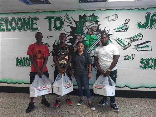 Mu Psi Chapter of Omega Psi Phi Fraternity donates donuts for Jackson 8th graders