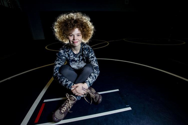 Lilly Sealy: HPC Wrestler seated on mats