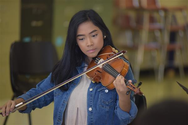 Student Plays Violin at High Point Central High School