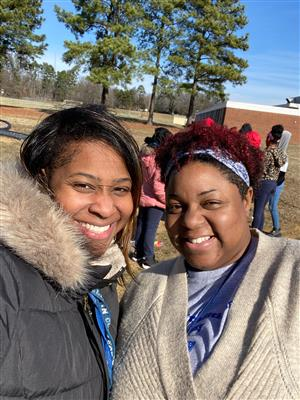 Ms. Brown and Ms. McLaurin on the playground.