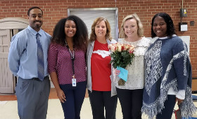 Photo of Mrs. Grubbs with the administrative staff