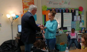 Ms. Hall receiving award for Fox 8 Educator of the Week