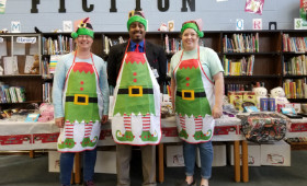Mr. Jordan with 2 PTA parents working at the holiday shop.