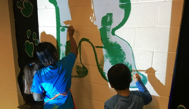 Students paint the R in our PRIDE wall