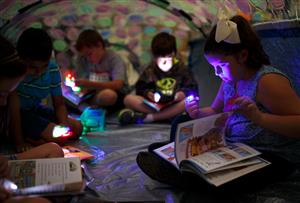 Students reading in tent