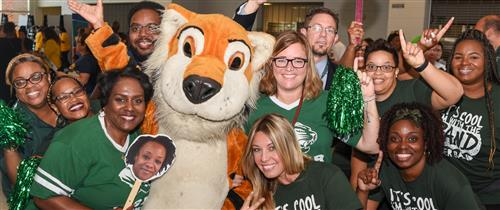 GCS Employees posing with a Tiger school mascot