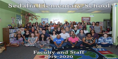 Staff of Sedalia Elementary smiling at camera