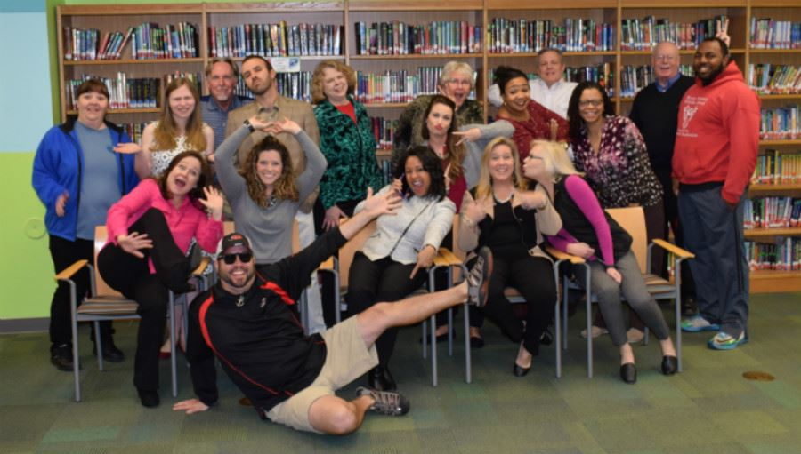 The staff of BSMS having fun with their photo.