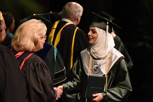 graduate shaking hands with board member