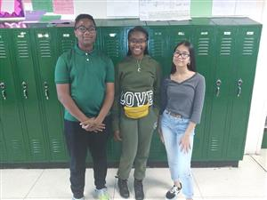 student council board members, three students standing in front of lockers