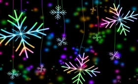 Black background with vivid multicolored snowflakes