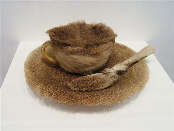Fur covered tea cup