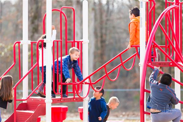 Students playing on playground.