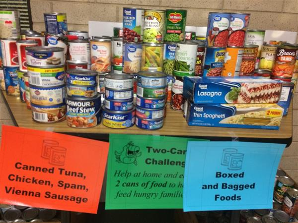 stacks of cans with signs saying canned food